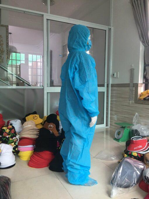 Quần áo bảo hộ chống dịch mặt phía bên hông màu xanh loại dùng cho người lớn liền thân dùng một lần