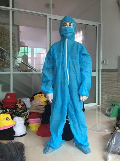Quần áo bảo hộ y tế mặt phía trước màu xanh loại dùng cho người lớn liền thân dùng một lần.